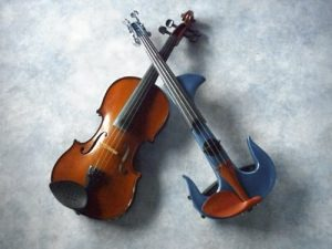 A traditional acoustic violin and a modern electronic violin from Marc Capuano